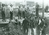 "Iron Mountain city workers """"boxing in"""" the mine creek on West Hughitt Street"