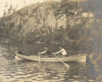 Teal Lake shoreline with men in rowboat